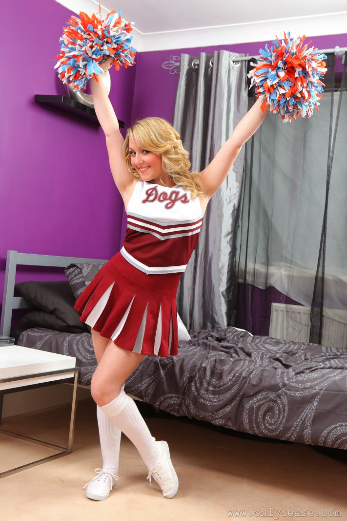 Sexy cheerleader stripping and showing off tight butt